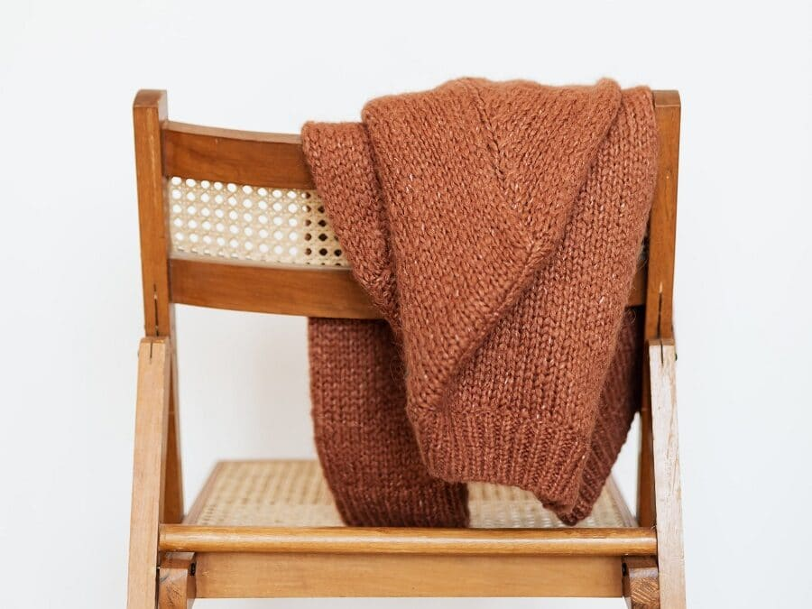 jumper left on the back of wooden chair