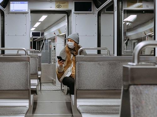 Woman on Train Wearing Mask