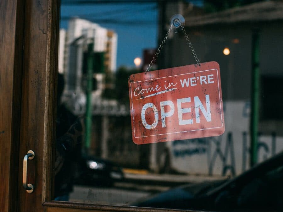 we're open signs hanging on door