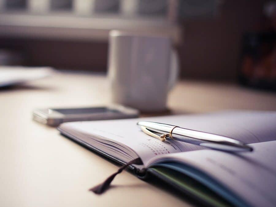 Pen Resting on a Hardback Diary
