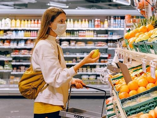 Woman Wearing Mask Shopping For Fruit