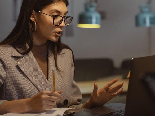 Woman Wearing Glasses Working at Laptop